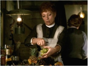 Babette lovingly prepares grapes for her guests