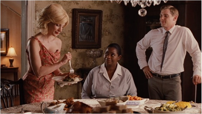 The master-maid roles are switched as Celia proudly serves Minny a homemade meal complete with crispy fried chicken.