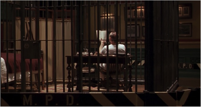 Lecter reads a novel in his cell.